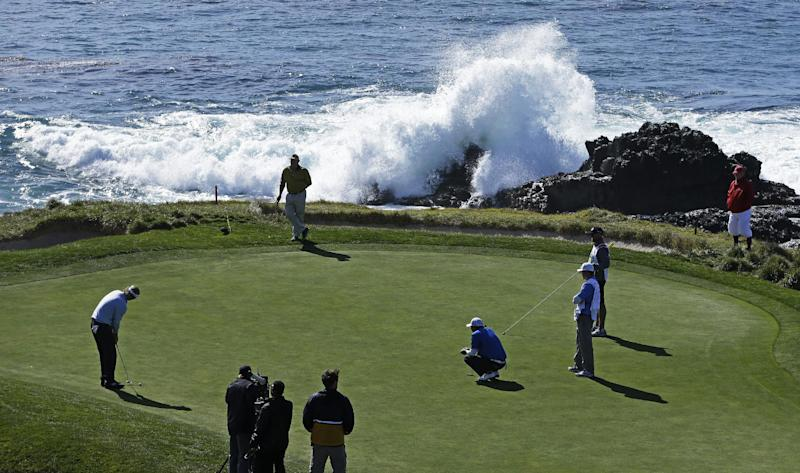 Brandt Snedeker, left, prepares to putt on the seventh green of the Pebble Beach Golf Course during the final round of the AT&T Pebble Beach Pro-Am golf tournament, Sunday, Feb. 10, 2013, in Pebble Beach, Calif. (AP Photo/Ben Margot)