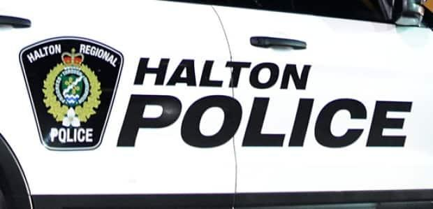Halton Regional Police say the accused, a 27-year-old Hamilton man whose full name is Hemant, went to the Oakville homeon Feb. 18 to carry out a quarantine compliance check. There, he allegedly demanded a cash fine and then sexually assaulted a resident when she refused to pay.  (Jeremy Cohn/CBC - image credit)