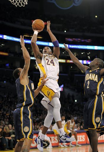 Los Angeles Lakers guard Kobe Bryant, center, puts up a shot as Indiana Pacers guard George Hill and guard Darren Collison defend during the first half of their NBA basketball game, Sunday, Jan. 22, 2012, in Los Angeles, Calif. (AP Photo/Mark J. Terrill)