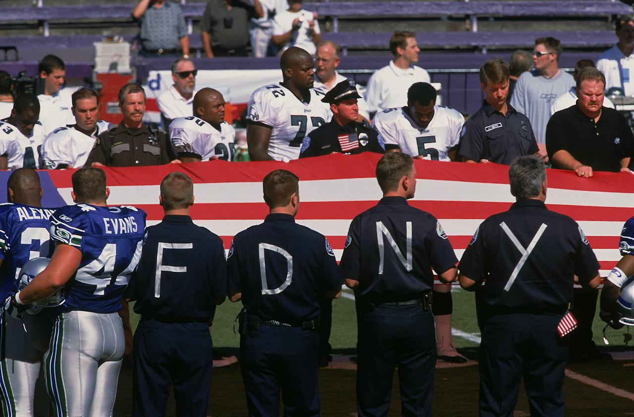 An American Flag is held in memory of 9/11 as the National Anthem is sung during opening cerimonies before the game between the Philadelphia Eagles and the Seattle Seahawks at the Husky Stadium in Seattle, Washington. The Eagles defeated the Seahawks 27-3.Mandatory Credit: Otto Greule /Allsport
