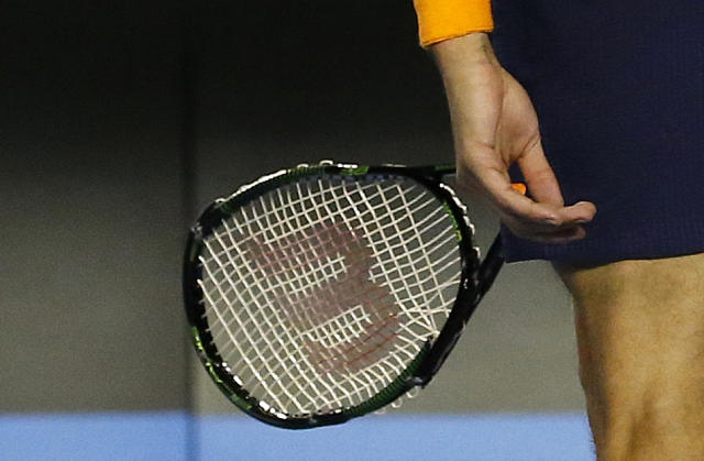 After a break to open the fifth set, Raonic's racquet paid a heavy price. (REUTERS/Issei Kato)