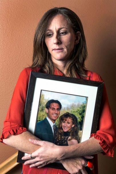 PHOTO: In this May, 15, 2014, file photo, Kim Goldman holds a photo of her with her late brother, Ron Goldman, killed along with his friend Nicole Brown Simpson in 1994, during an interview at her home in Santa Clarita, Calif. (Damian Dovarganes/AP, FILE)