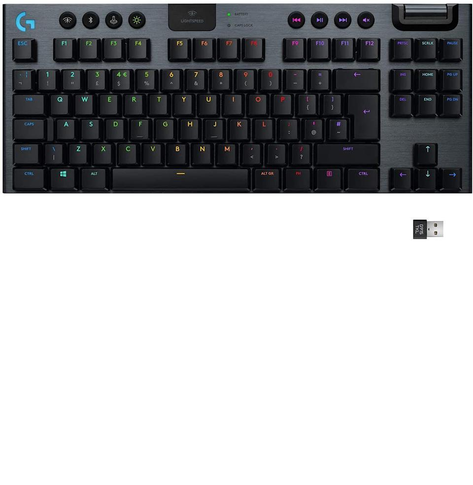 """<p><strong>Logitech </strong></p><p>amazon.com</p><p><strong>$187.16</strong></p><p><a href=""""https://www.amazon.com/dp/B085RLZ1C4?tag=syn-yahoo-20&ascsubtag=%5Bartid%7C10054.g.37143199%5Bsrc%7Cyahoo-us"""" rel=""""nofollow noopener"""" target=""""_blank"""" data-ylk=""""slk:Buy"""" class=""""link rapid-noclick-resp"""">Buy</a></p><p><a href=""""https://www.esquire.com/lifestyle/a29152446/logitech-g-series-wireless-mouse-charging-pad-review-endorsement/"""" rel=""""nofollow noopener"""" target=""""_blank"""" data-ylk=""""slk:Logitech has quickly become my go-to"""" class=""""link rapid-noclick-resp"""">Logitech has quickly become my go-to</a> for gaming needs. Yes, its products are all pricey, but they're more than worth it. I hate cords, and while the pro gamers often insist you need cords for faster response rate, Logitech said. """"No, you can be a pro gamer <em>and</em> have a cord-free desk."""" For that I owe Logitech all the money I'm going to win at the next <em>Fortnite</em> World Cup. The Logitech G915 not only has lightning-fast response rates, even while being Bluetooth (courtesy of Logitech Lightspeed tech), but it also looks cool as hell. There's this interesting levitating key thing that works with Logitech's RGB Lightsync, which is obviously the most crucial gaming keyboard feature. The G915 is also just generally pretty, with the metallic back behind the plastic keys making it great for the gamer/young professional combo. There are few people I wouldn't recommend this keyboard for, and that in of itself is a massive feat.</p>"""