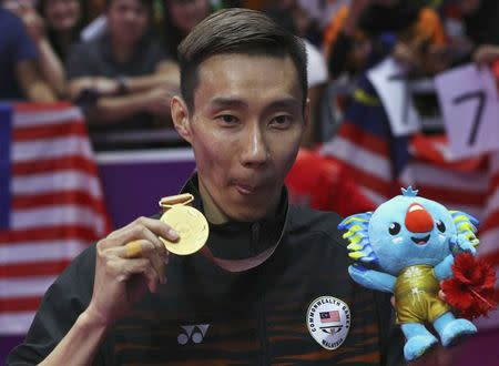 Badminton - Gold Coast 2018 Commonwealth Games - Men's Singles - Carrara Sports Arena 2 - Gold Coast, Australia - April 15, 2018. Gold medallist Lee Chong Wei of Malaysia shows his medal. REUTERS/Athit Perawongmetha