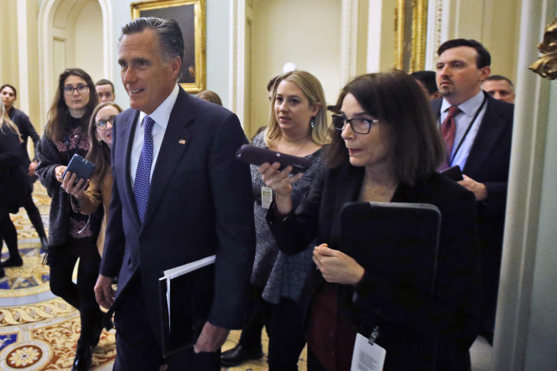 Sen. Mitt Romney, R-Utah, walks to a Republican luncheon outside the Senate chamber prior to the start of the impeachment trial of President Donald Trump at the U.S. Capitol Friday Jan 31, 2020, in Washington, as Senators continue the impeachment trial for President Donald Trump. (AP Photo/Steve Helber)