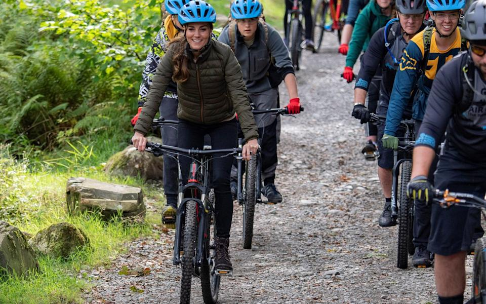 Kate looks at ease as she mountain bikes with a group of Air Cadets