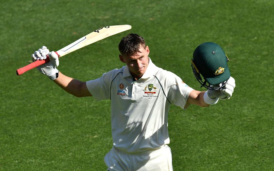 Marnus Labuschagne of Australia acknowledges the crowd as he leaves the field after scoring 185 runs during day three of the first Test match between Australia and Pakistan at the Gabba —County Championship 2021 predictions and your club-by-club guide - Darren England/EPA