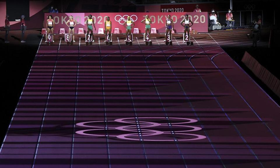 Athletes before the start of the women's 100m athletics final.