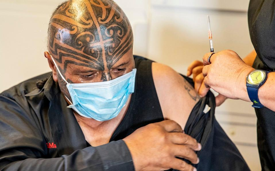 Rangi McLean receives his vaccine at the Manurewa Marae vaccination centre in south Auckland - New Zealand Herald