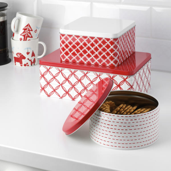 This photo provided by IKEA shows their reusable Vinterfest Tins. While the holiday season is a time of giving and thoughtfulness, it can also be a time of excess and waste. Americans throw away 25 percent more trash than usual between Thanksgiving and New Year's, that's about a million extra tons of garbage each week, according to the National Environmental Education Foundation (NEEF), a Washington, D.C.-based nonprofit group devoted to helping people to be more environmentally responsible. (IKEA via AP)