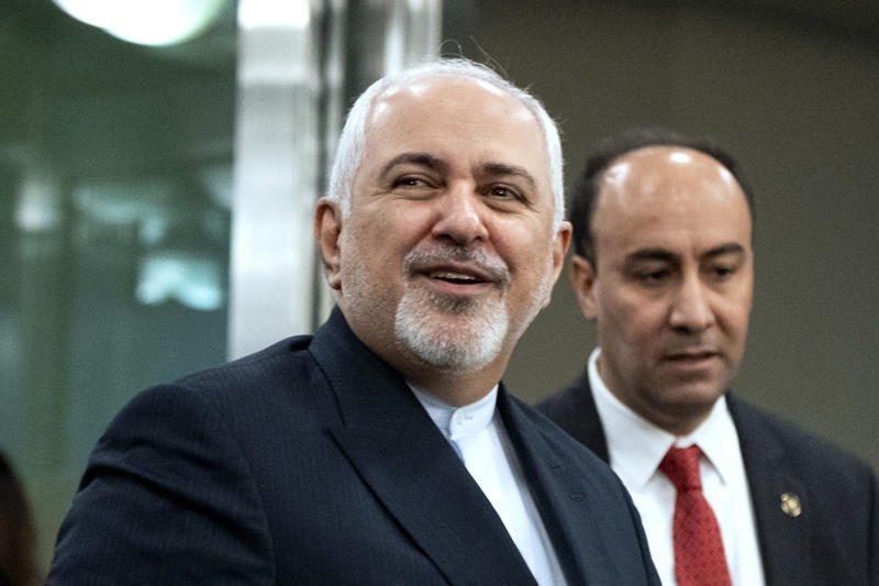 """FILE - In this Sept. 23, 2019, file photo, Iranian Foreign Minister Mohammad Javad Zarif, left, arrives for the 74th session of the United Nations General Assembly, at U.N. headquarters. Iran on Saturday criticized the United States for what it called an """"inhumane"""" decision to bar its foreign minister who was attending the U.N. summit meetings in New York from visiting a hospitalized Iranian diplomat in the city. (AP Photo/Craig Ruttle, File)"""