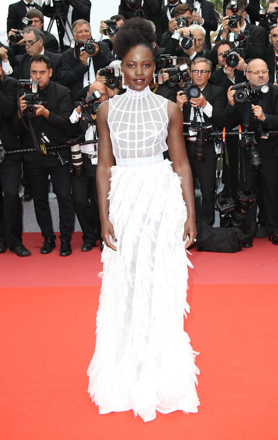 <p>For the 'Sorry Angel (Plaire, Aimer Et Courir Vite)' premiere, Lupita stunned in a white, feathered gown by Dior.<em> [Photo: Getty]</em> </p>