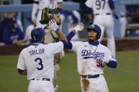 Los Angeles Dodgers' Mookie Betts, right, celebrates his two-run home run with Chris Taylor during the second inning of a baseball game against the San Diego Padres, Thursday, Aug. 13, 2020, in Los Angeles. (AP Photo/Jae C. Hong)