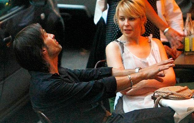 Kylie and Olivier share a laugh during a date back when they were in a relationship the first time around. Source: Getty
