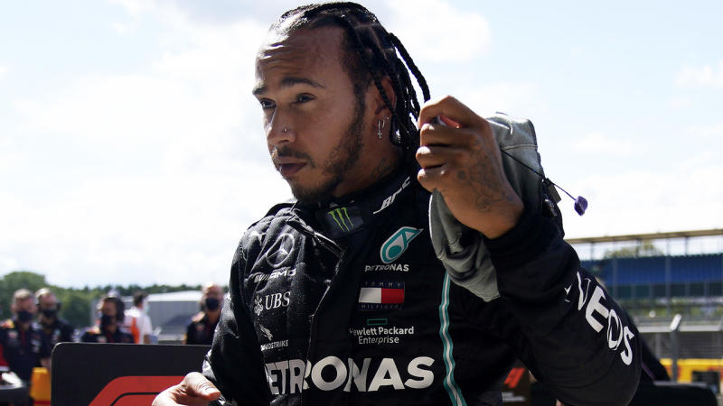 Lewis Hamilton is pictured getting out of his car after qualifying on pole position at the British Grand Prix.