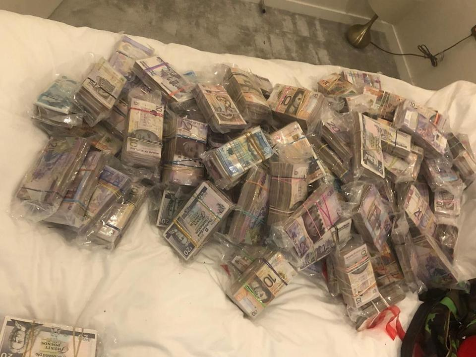 A quantity of cash seized by officers under Operation Venetic in London: Metropolitan Police