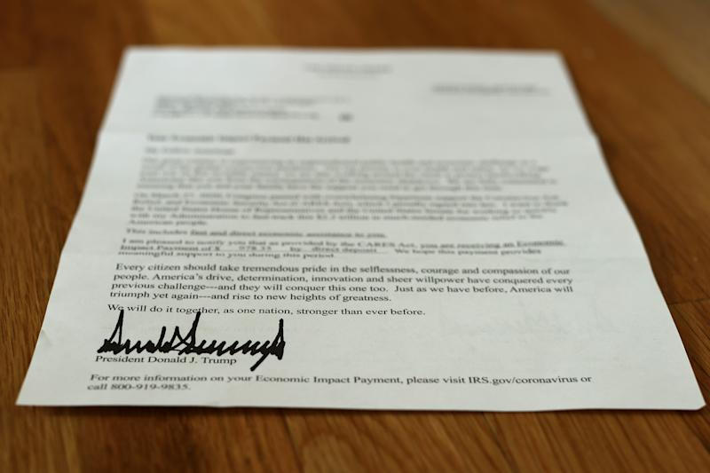 WASHINGTON, DC - APRIL 29: A letter bearing the signature of U.S. President Donald Trump was sent to people who received a coronavirus economic stimulus payment as part of the Cares Act April 29, 2020 in Washington, DC. The letter had a return address for the Internal Revenue Service in Austin, Texas, but was printed on White House letterhead. The initial 88 million payments totaling nearly $158 billion were sent by the Treasury Department last week as most of the country remains under stay-at-home orders due to the COVID-19 pandemic. (Photo by Chip Somodevilla/Getty Images)