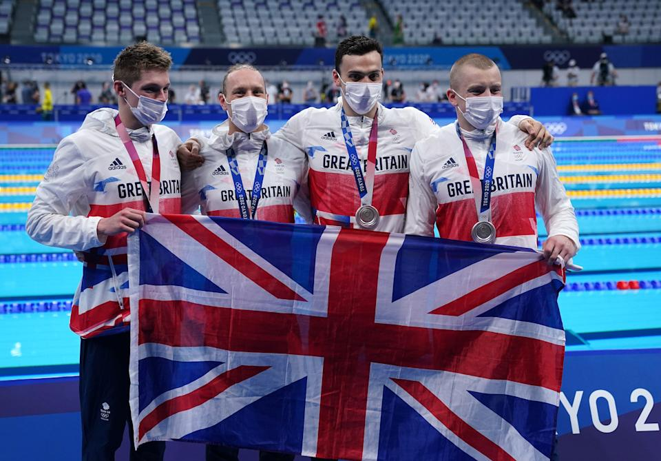 Great Britain's (left-right) Duncan Scott, Luke Greenbank, James Guy and Adam Peaty after winning the silver medal in the men's 4x100m medley relay (Joe Giddens/PA) (PA Wire)