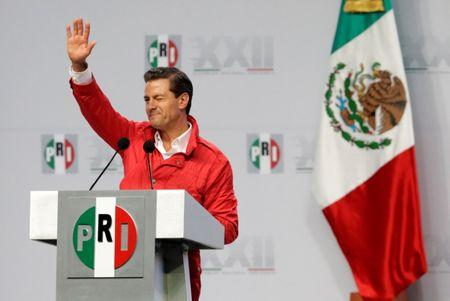 Mexican President Enrique Pena Nieto delivers his speech to supporters of the Institutional Revolutionary Party (PRI) during their national assembly ahead of the 2018 election at Mexico City's Palacio de los Deportes, Mexico August 12, 2017. REUTERS/Henry Romero