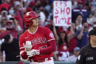 Los Angeles Angels designated hitter Shohei Ohtani stands on third after hitting an Rbi triple during the first inning of a baseball game against the Seattle Mariners Saturday, Sept. 25, 2021, in Anaheim, Calif. (AP Photo/Mark J. Terrill)