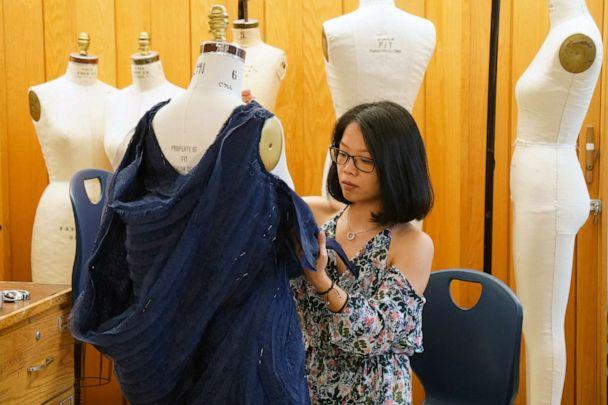 PHOTO: Baoqing Yu (FIT student) works on design for Ariel ('The Little Mermaid') inspired garments. (Disney)