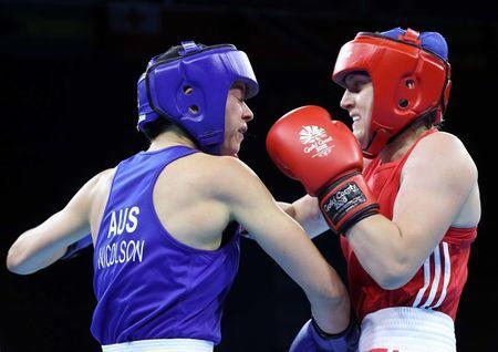 Boxing - Gold Coast 2018 Commonwealth Games - Women's 57kg Final Bout - Oxenford Studios - Gold Coast, Australia - April 14, 2018. Michaela Walsh of Northern Ireland in action with Skye Nicolson of Australia. REUTERS/Athit Perawongmetha