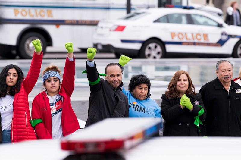 Immigration protesters, including Rep. LuisGutiérrez (center), stand in a line after being arrested at the U.S. Capitol on Dec. 6.