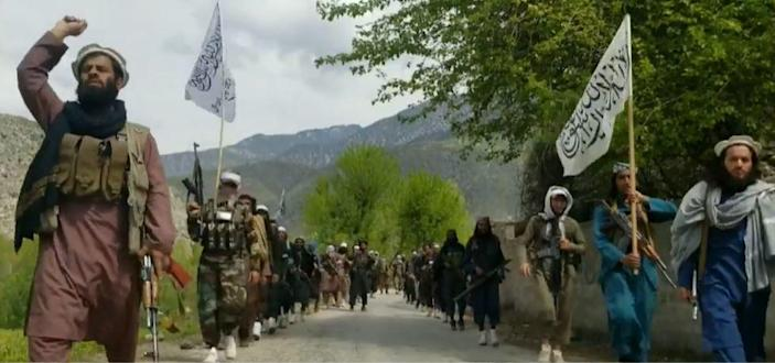 Taliban militants parade down a road in Afghanistan's Laghman province in April 2021. / Credit: CBS