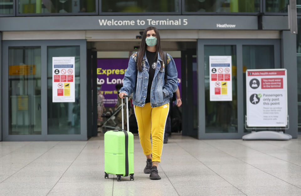 Celia Gonzalez arrives at Heathrow Airport's Terminal 5, after people returning from Spain were told they must quarantine when they return home.