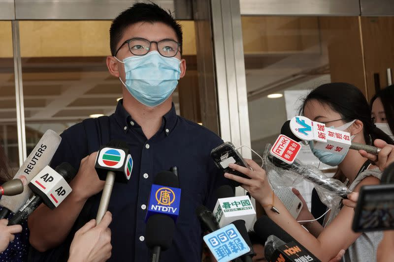 Pro-democracy activist Joshua Wong speaks to the media at the High Court in Hong Kong