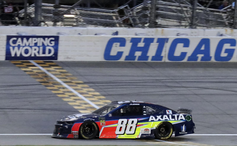 Alex Bowman crosses the finish line to win the NASCAR Cup Series auto race at Chicagoland Speedway in Joliet, Ill., Sunday, June 30, 2019. (AP Photo/Nam Y. Huh)