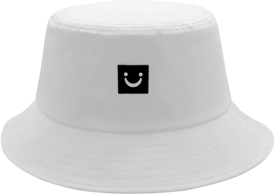 """<h2>Smiley Face Bucket Hat<br></h2><br>This bucket hat left you on read for three days. <br><br><strong>HSYZZY</strong> Smiley Face Bucket Hat, $, available at <a href=""""https://www.amazon.com/Smiley-Bucket-Protection-Packable-Outdoor/dp/B08CZFV6PW"""" rel=""""nofollow noopener"""" target=""""_blank"""" data-ylk=""""slk:Amazon"""" class=""""link rapid-noclick-resp"""">Amazon</a>"""