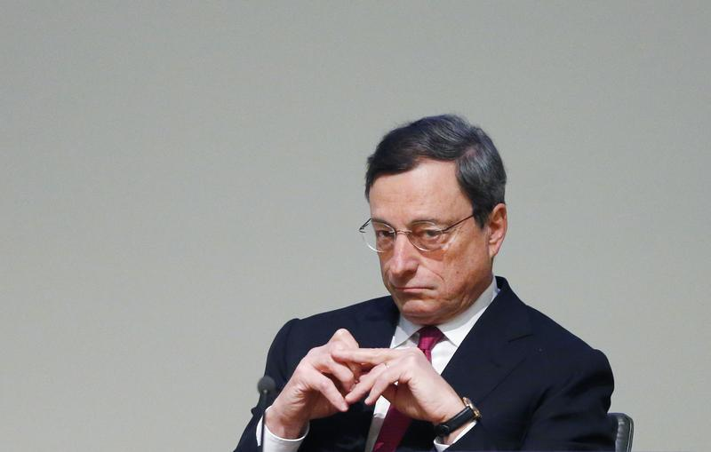 ECB President Draghi waits to deliver a speech at a conference in Brussels