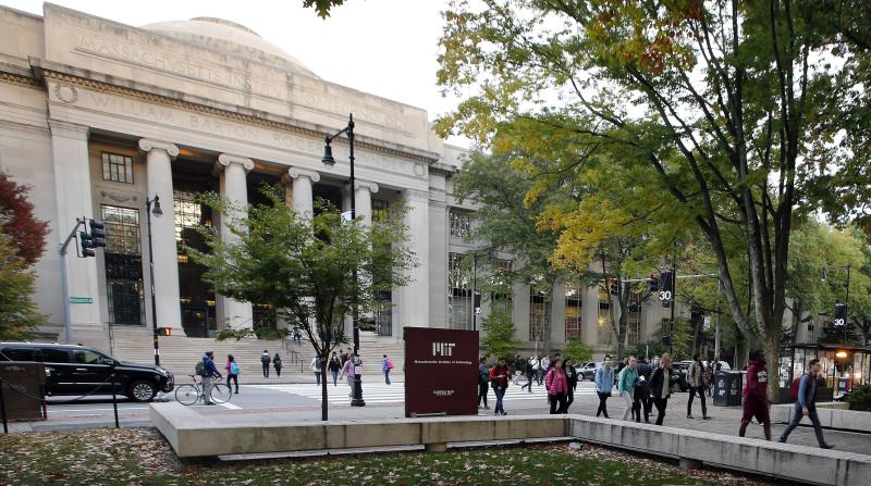 """FILE - In this Oct. 21, 2015, file photo, students walk on the Massachusetts Institute of Technology campus in Cambridge, Mass. Disgraced financier Jeffrey Epstein donated more than $700,000 to the Massachusetts Institute of Technology and visited campus at least nine times after being convicted of sex crimes in 2008, according to new findings from a law firm hired to investigate Epstein's ties with the elite school, Friday, Jan. 10, 2020. MIT President L. Rafael Reif called the findings """"a sharp reminder of human fallibility and its consequences.""""  ( AP Photo/Michael Dwyer, File)"""