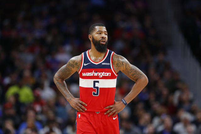 "The <a class=""link rapid-noclick-resp"" href=""/nba/teams/washington/"" data-ylk=""slk:Wizards"">Wizards</a> dealt forward <a class=""link rapid-noclick-resp"" href=""/nba/players/4894/"" data-ylk=""slk:Markieff Morris"">Markieff Morris</a> to the <a class=""link rapid-noclick-resp"" href=""/nba/teams/new-orleans/"" data-ylk=""slk:Pelicans"">Pelicans</a> in an effort to get under the luxury tax threshold. (AP Photo/Duane Burleson)"