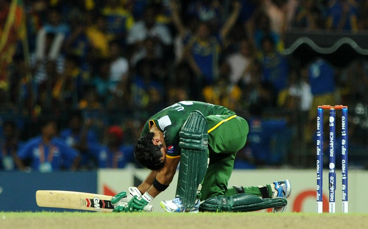 Pakistan cricketer Umar Akmal reacts after Sri Lanka's victory in the ICC Twenty20 Cricket World Cup's semi-final match between Sri Lanka and Pakistan at the R. Premadasa International Cricket Stadium in Colombo on October 4, 2012. Sri Lanka, restricted to 139-4 after electing to bat, hit back to keep Pakistan down to 123-7 in a thrilling semi-final before 35,000 fans at the Premadasa stadium. AFP PHOTO/Ishara S. KODIKARA
