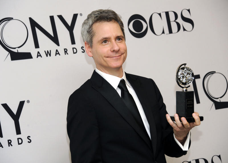 "FILE - In this June 10, 2012 file photo, Bruce Norris poses with his Best Play award for ""Clybourne Park"" in the press room at the 66th annual Tony Awards, in New York. The Pulitzer Prize-winning playwright of ""Clybourne Park"" says he withdrew permission for a Berlin theater company to produce the play after learning that one of the actors would perform the roles in blackface. (Photo by Evan Agostini /Invision/AP, File)"