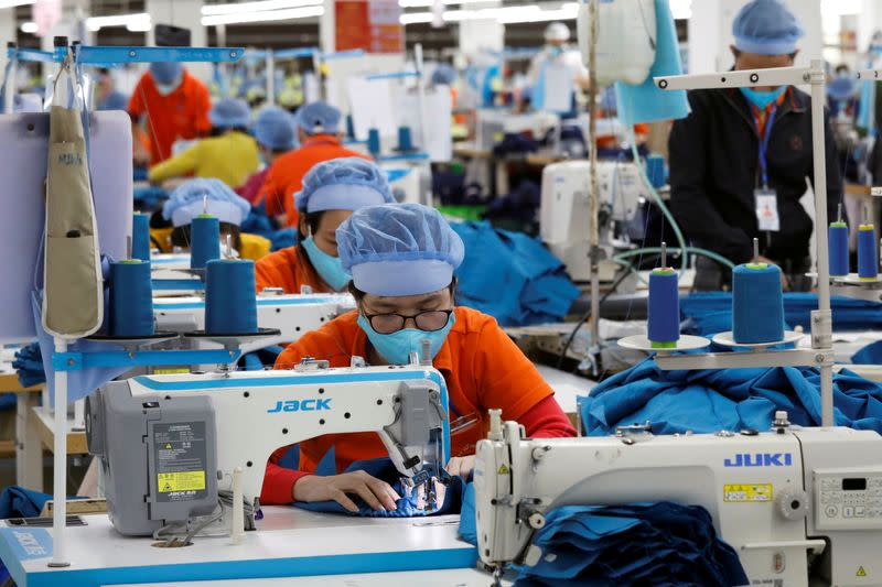 FILE PHOTO: Workers make garment products for export at a factory in Hung Yen province, Vietnam