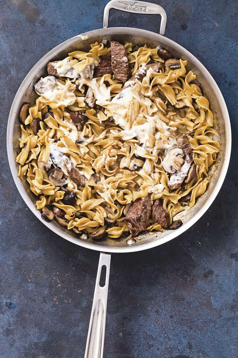 """<p>Another one-pan weeknight hero that is insanely flavorful, white wine and beef broth deglaze the umami bits of sirloin in the pan.</p><p><em><a href=""""https://www.goodhousekeeping.com/food-recipes/easy/a24178537/beef-stroganoff-recipe/"""" rel=""""nofollow noopener"""" target=""""_blank"""" data-ylk=""""slk:Get the recipe for Beef Stroganoff »"""" class=""""link rapid-noclick-resp"""">Get the recipe for Beef Stroganoff »</a></em></p>"""