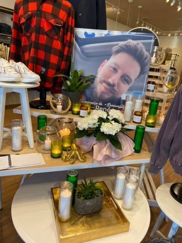 Boutique Evasion, where 25-year-old Rene Doiron worked, stopped all sales on Tuesday and turned the store into a gathering spot for mourning villagers.  (Submitted by Jamie Alexander - image credit)