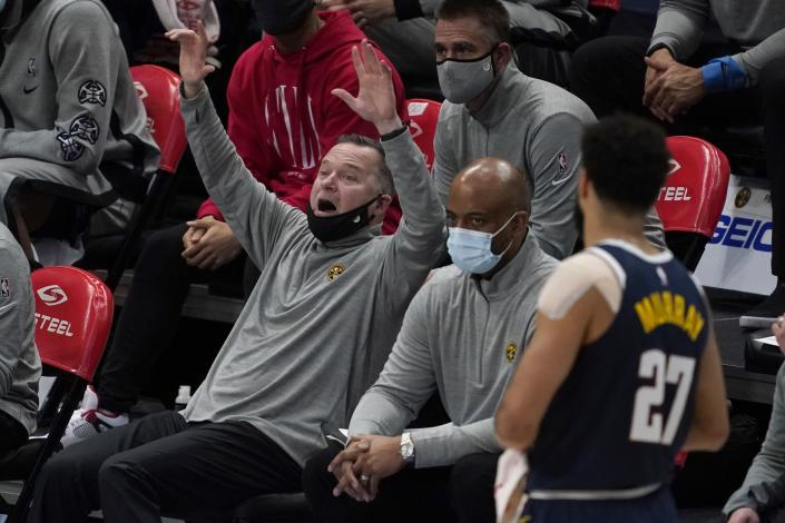 Denver Nuggets head coach Michael Malone instructs the team as guard Jamal Murray (27) looks on in the second half of an NBA basketball game against the Dallas Mavericks in Dallas, Monday, Jan. 25, 2021. (AP Photo/Tony Gutierrez)