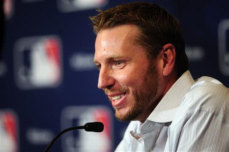 Roy Halladay announces his retirement the MLB Winter Meetings at Walt Disney World Swan and Dolphin Resort. David Manning-USA TODAY Sports