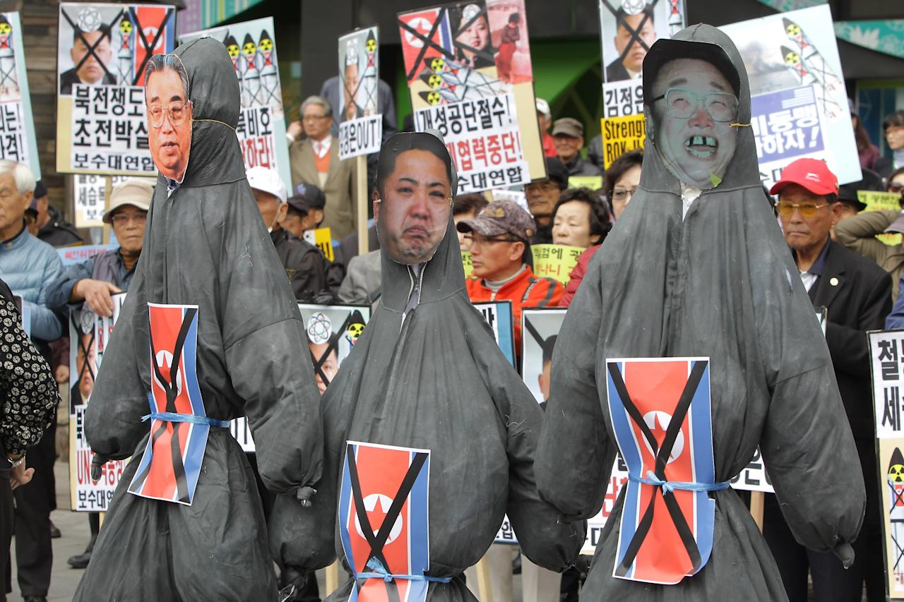SEOUL, SOUTH KOREA - APRIL 15:  South Korean conservative hold effigies of North Korea national founder Kim Il-Sung, former North Korean leader Kim Jong-Il and now leader Kim Jong-Un during an anti-North Korea rally on April 15, 2013 in Seoul, South Korea. North Korea marks its founder Kim Il-Sung's 101th birthday today while the fear on possible missile launch continues.  (Photo by Chung Sung-Jun/Getty Images)