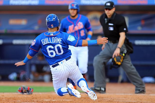 <p>New York Mets Luis Guillorme (60) goes airborne as he scores in the eighth inning of a baseball game against the Atlanta Braves at First Data Field in Port St. Lucie, Fla., Feb. 23, 2018. (Photo: Gordon Donovan/Yahoo News) </p>