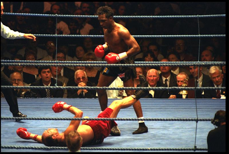 Benn stands over Louis Gent during their Super Middleweight world title fight in June 1993.