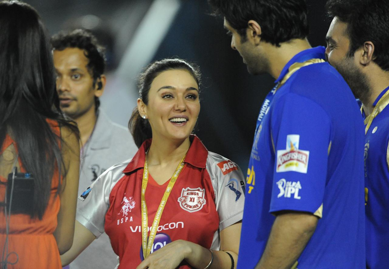Kings XI Punjab co-owner and Bollywood actress Preity Zinta gestures during the IPL Twenty20 cricket match between Kings XI Punjab and Rajasthan Royals at the Punjab Cricket Association (PCA) stadium in Mohali on May 5, 2012. RESTRICTED TO EDITORIAL USE. MOBILE USE WITHIN NEWS PACKAGE. AFP PHOTO/RAVEENDRAN        (Photo credit should read RAVEENDRAN/AFP/GettyImages)