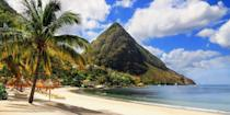 """<p>While St. Lucia has its share of palm-fringed beaches, the island's most beloved feature are the <a href=""""https://go.redirectingat.com?id=74968X1596630&url=https%3A%2F%2Fwww.tripadvisor.com%2FAttraction_Review-g147342-d150512-Reviews-Pitons-St_Lucia.html&sref=https%3A%2F%2Fwww.redbookmag.com%2Flife%2Fg36983737%2Fmost-beautiful-islands-in-the-world%2F"""" rel=""""nofollow noopener"""" target=""""_blank"""" data-ylk=""""slk:Pitons"""" class=""""link rapid-noclick-resp"""">Pitons</a>, a pair of volcanic peaks visible from almost every part of the island. Rainforest treks, West Indian cuisine, and rum punches round out the experience. </p>"""