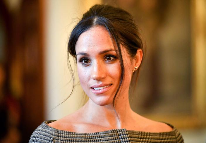 <p>Meghan Markle chats with people inside the Drawing Room during a visit to Cardiff Castle on January 18, 2018 in Cardiff, Wales.</p> (Photo by Ben Birchall - WPA Pool / Getty Images)