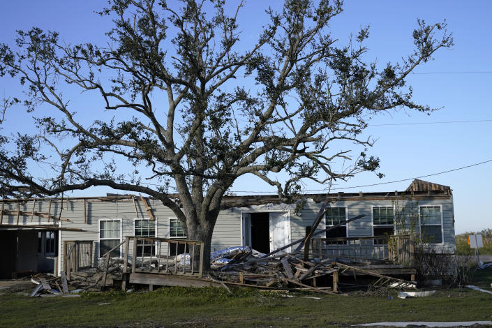 A destroyed home is seen in the aftermath of both Hurricane Laura and Hurricane Delta, in Grand Lake, La., Friday, Dec. 4, 2020. (AP Photo/Gerald Herbert)