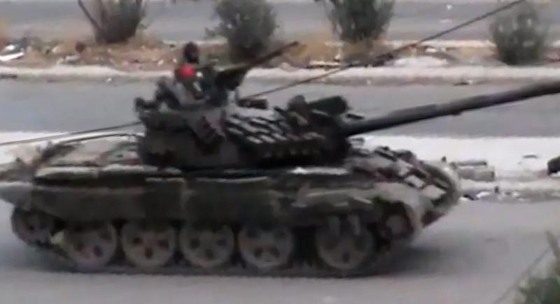 This image taken from video obtained from the Shaam News Network, which has been authenticated based on its contents and other AP reporting, purports to show a Syrian military tank in Daraa, Syria, on Tuesday, Oct. 2, 2012. (AP Photo/Shaam News Network via AP video)